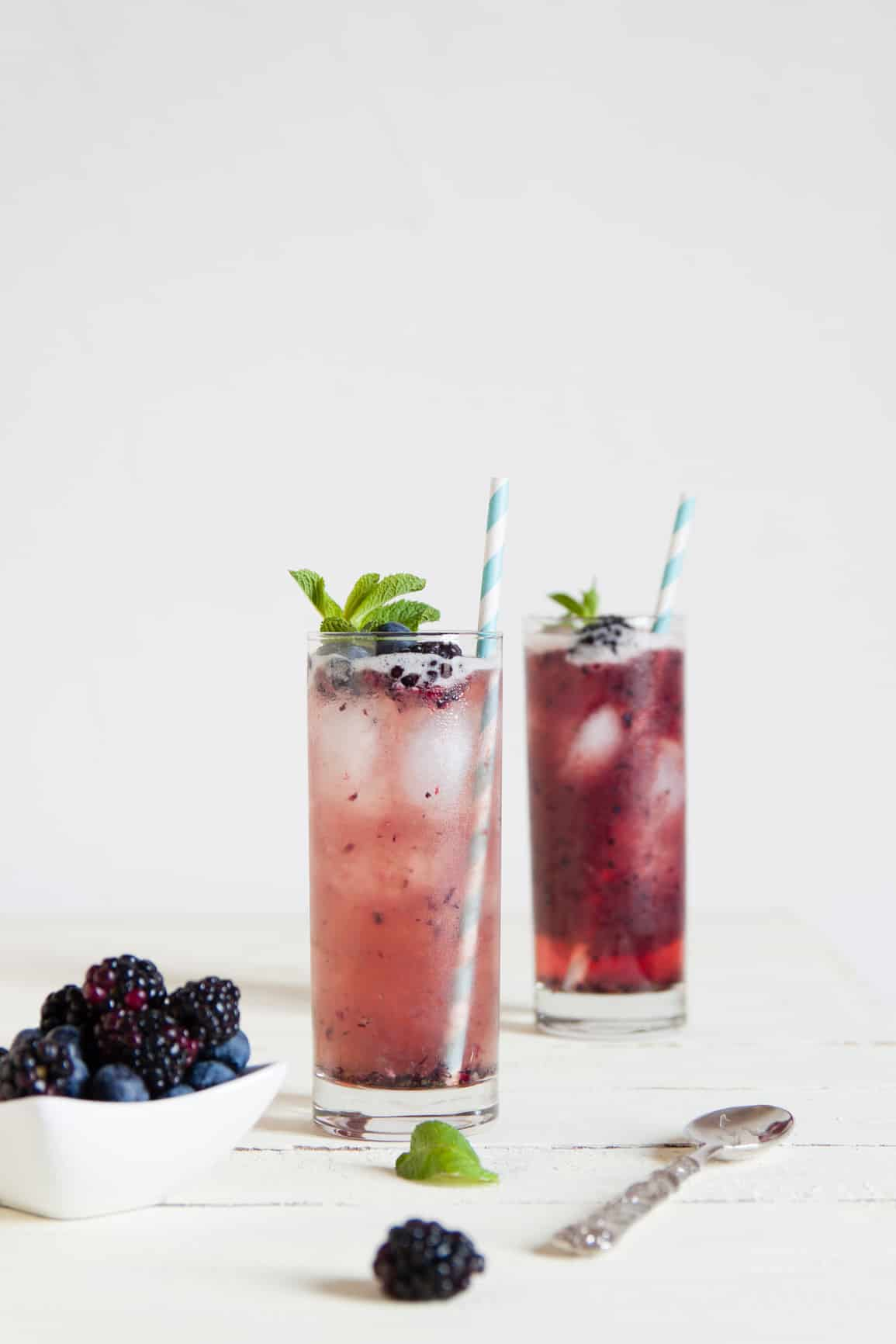 An easy recipe of Mixed Berry Mojitos. It's a simple yet refreshing mojito cocktail to make for a crowd at parties. Blended with blueberries, blackberries, fresh mint, vodka and lime juice, it's the perfect drink when hosting parties.