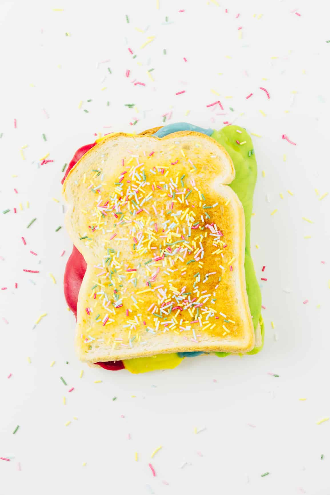 This rainbow-colored grilled cheese sandwich recipe is a fun twist on the classic grilled cheese sandwich and it's super easy to make. It should take no more than 10 minutes to make and pairs perfectly with a bowl of tomato soup to enjoy this fall and winter!
